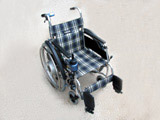 Electric wheelchair (possible reshuffling for manual operation) for right-handed person